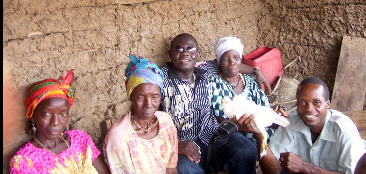 PFL Director, Reverend Kollie (left) reunites former detainee (far right) with his family