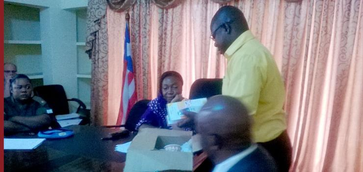 PFL Director, Reverend Kollie presented the thermometers to Minister of Justice.