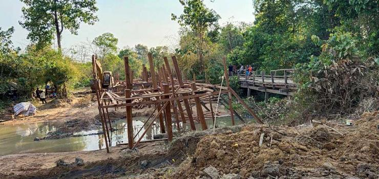 Construction on the 27-meter bridge as agreed upon by the Mesco Gold (Cambodia) Ltd. mining company