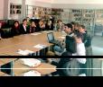 John Christensen discusses international legal databases at Ilia State University law library.
